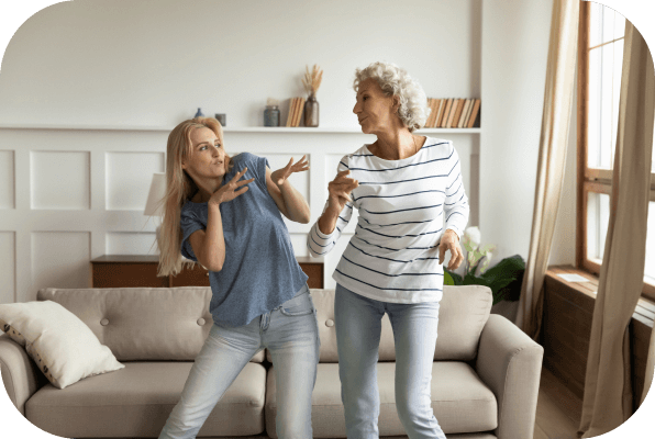 Caregiver and mom dancing